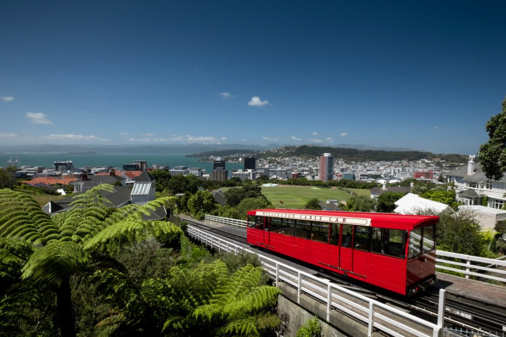 Looking over the city of Wellington, New Zealand you can see the famous Cable Car approaching the viewing deck as seen on the City to Sea Walkway.