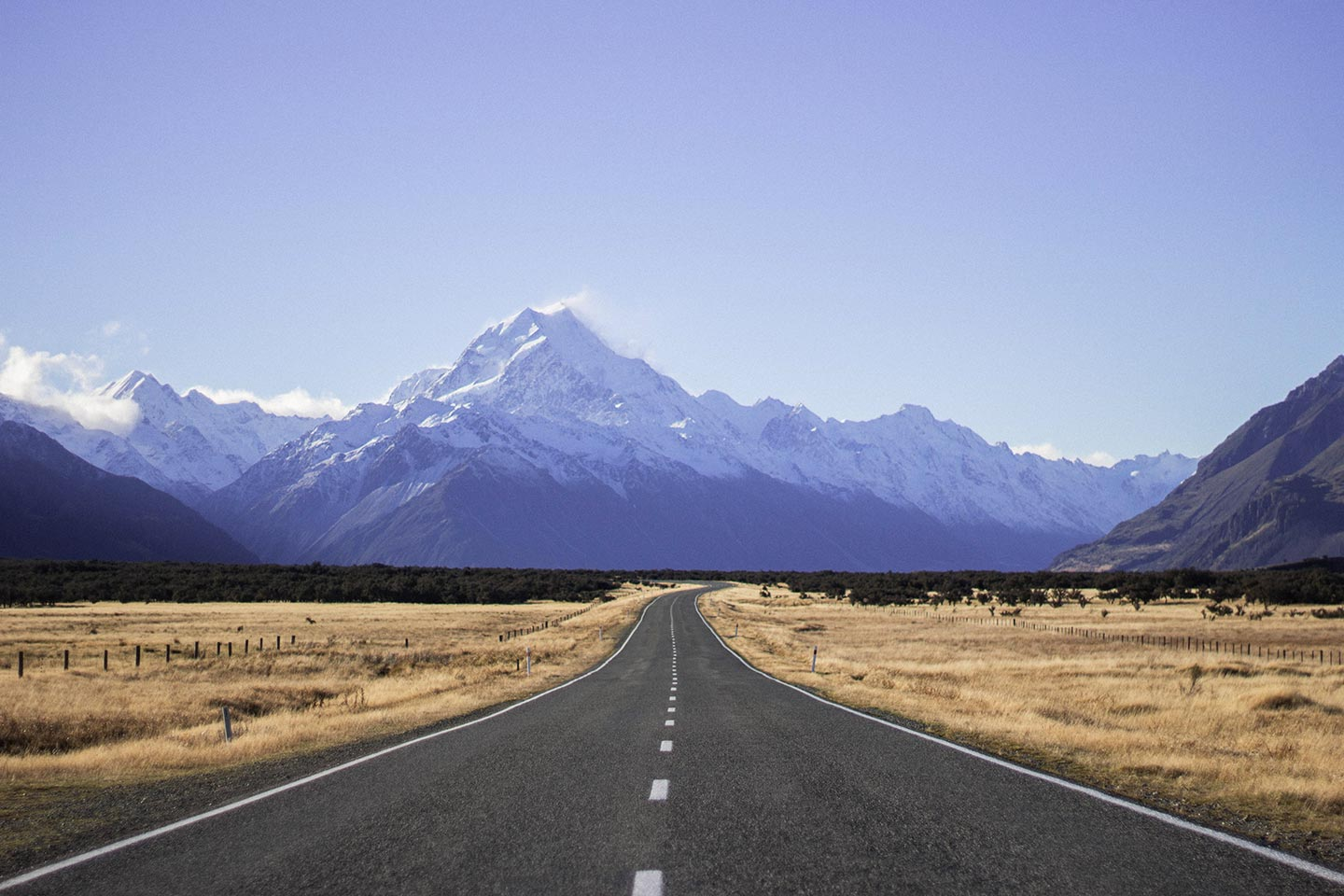 A road leading towards a large mountain range in New Zealand. This is a perfect example of a landscape photographer using leading lines in their photos.