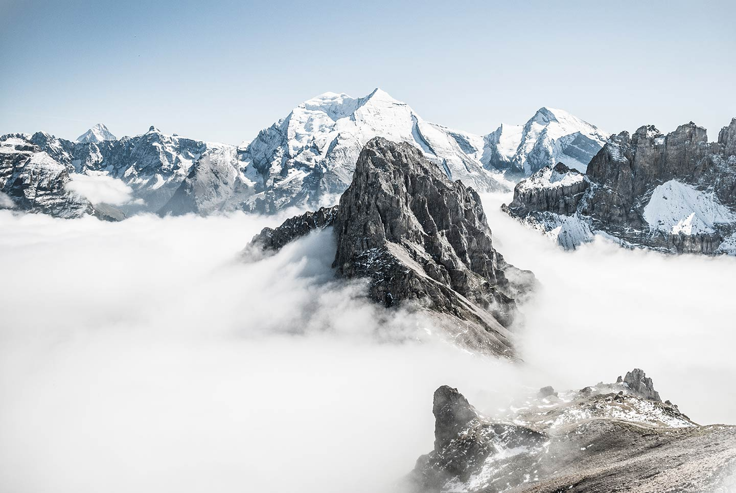 A mountain range that extends above the clouds. A perfect example of a landscape photographer capturing a photo using the correct settings.