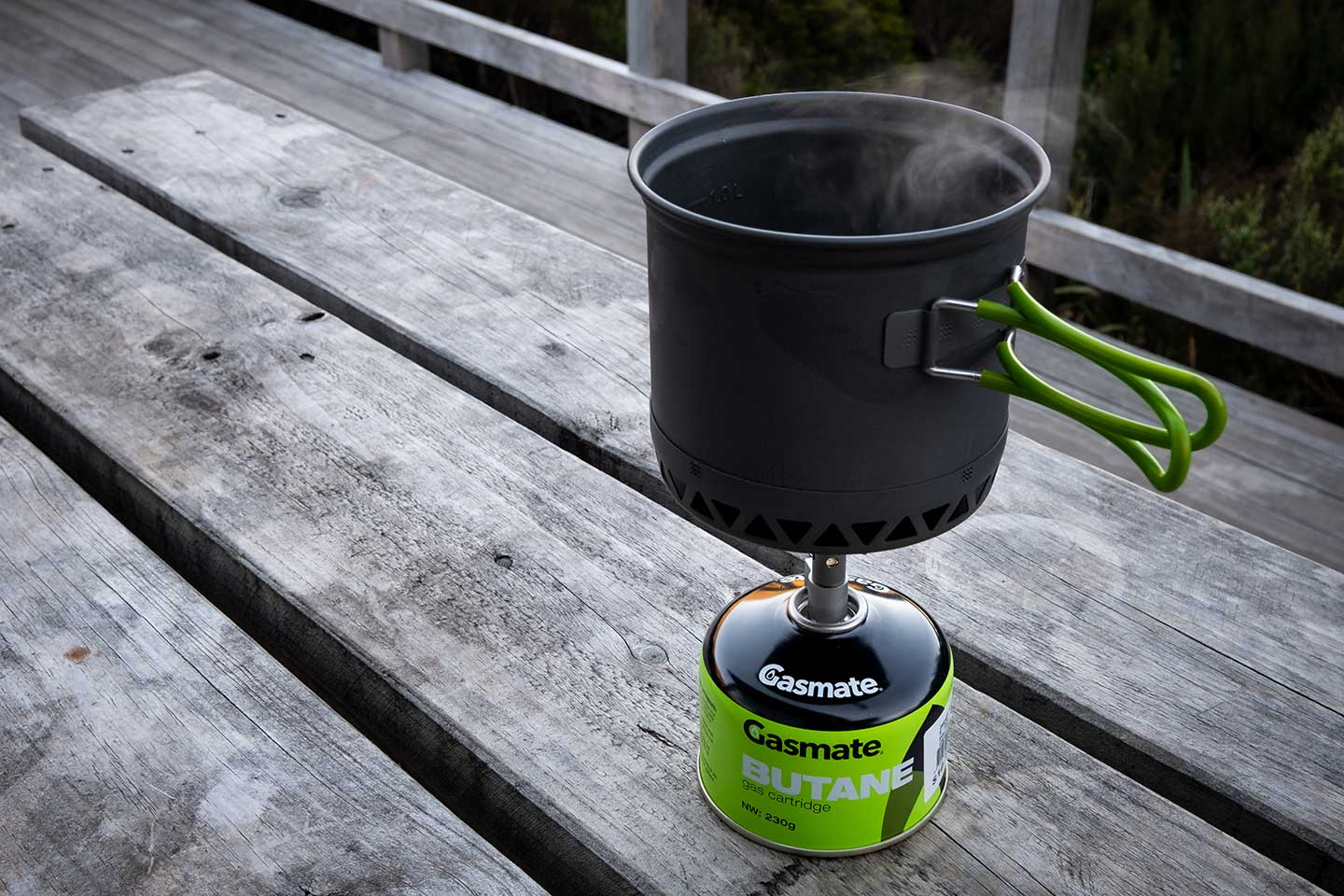A backpackers stove with a pot of boiling water on top. Both very important parts of any Great Walks packing list.