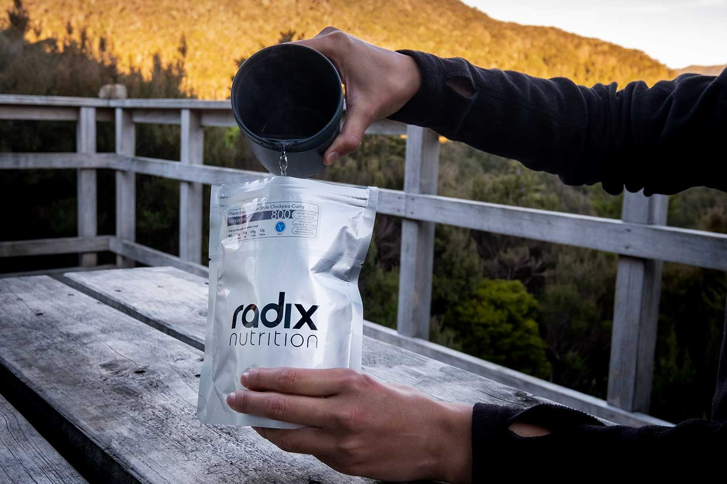Pouring boiling water into a Radix Nutrition chickpea curry.