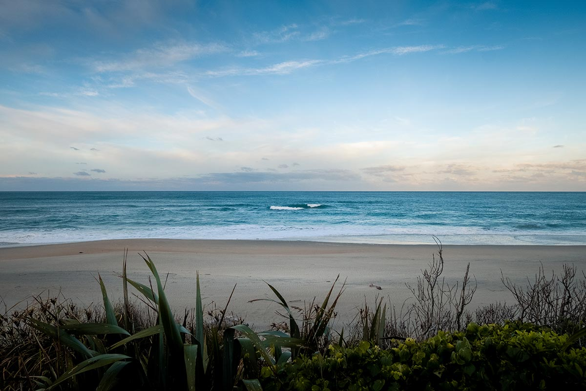 A beautiful beach with turquoise blue waters. This particular beach is found along a stretch of the Heaphy Track in New Zealand.