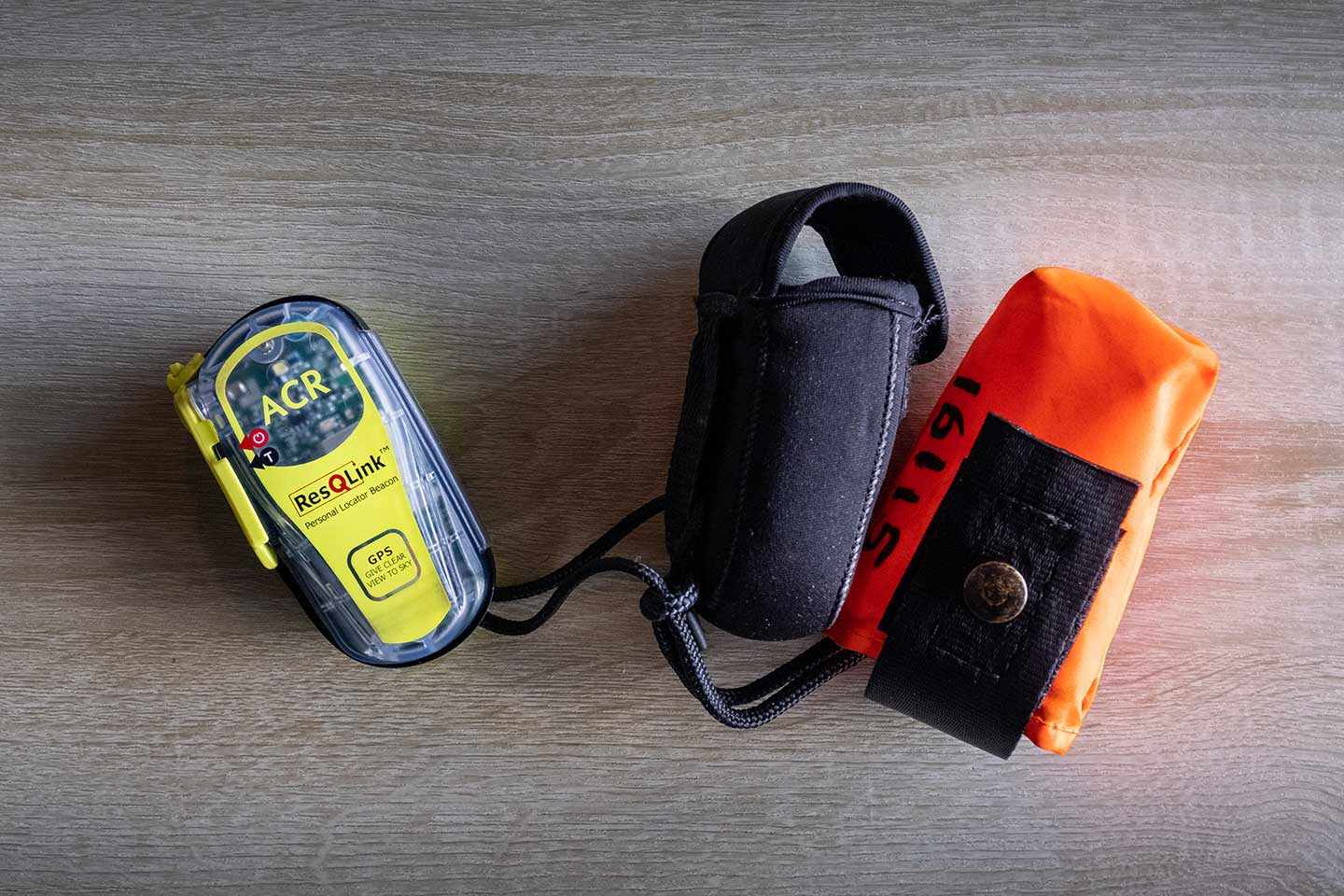 A personal locator beacon on a table. An important piece of safety equipment that should be part of any Great Walks packing list.