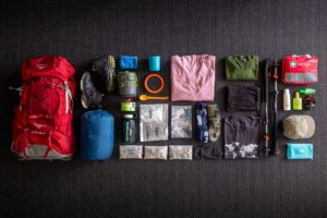 The contents of a trampers bag laid out on the floor.